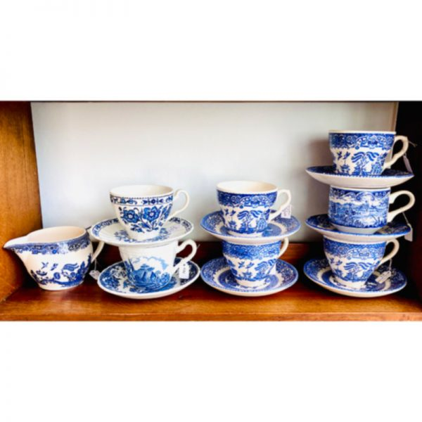 blue and white cups and saucers